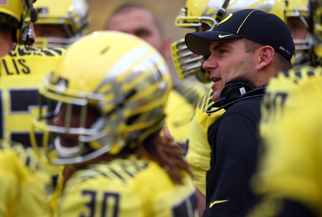 Hi-res-180572723-head-coach-mark-helfrich-of-the-oregon-ducks-watches_crop_650