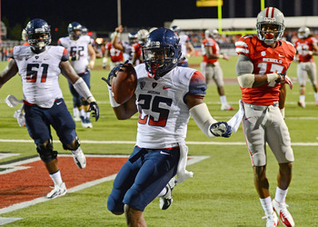 Hi-res-180033989-kadeem-carey-of-the-arizona-wildcats-scores-a-touchdown_display_image
