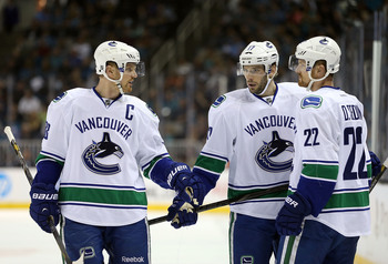 Hi-res-168287247-henrik-sedin-ryan-kesler-and-daniel-sedin-of-the_display_image
