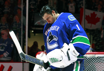 Hi-res-168241190-roberto-luongo-of-the-vancouver-canucks-looks-on-from_display_image