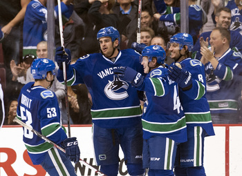 Hi-res-181714607-tom-sestito-of-the-vancouver-canucks-celebrates-with-bo_display_image