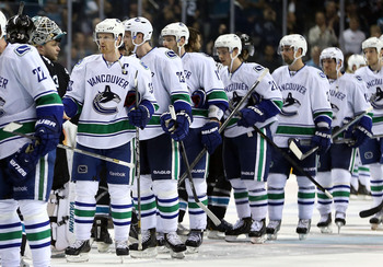 Hi-res-168288671-henrik-sedin-and-the-vancouver-canucks-shake-hands-with_display_image
