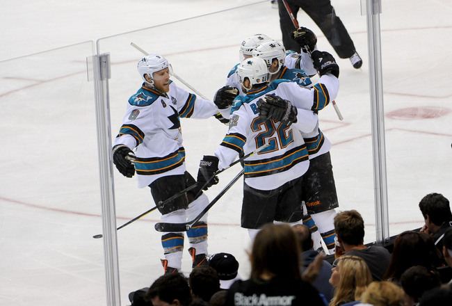 Hi-res-169932153-the-san-jose-sharks-celebrate-after-a-goal-against-the_crop_650x440