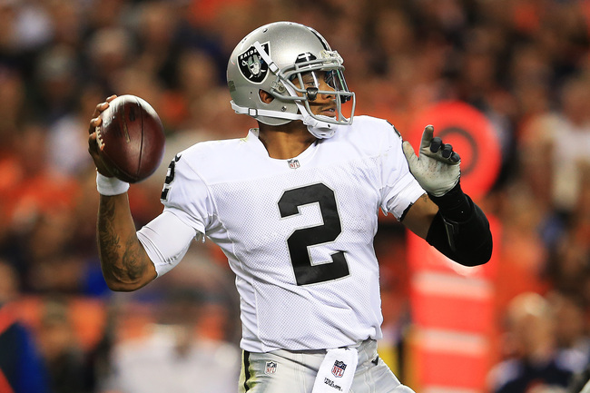 DENVER, CO - SEPTEMBER 23:   Terrelle Pryor #2 of the Oakland Raiders thows a second quarter touchdown pass against the Denver Broncos at Sports Authority Field at Mile High on September 23, 2013 in Denver, Colorado.  (Photo by Doug Pensinger/Getty Images