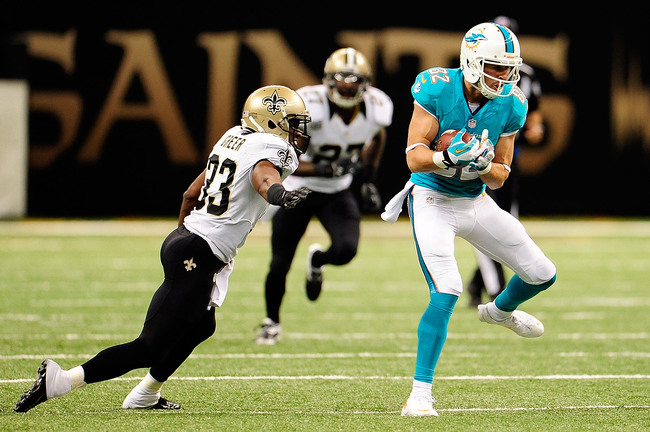 Hi-res-182563803-brian-hartline-of-the-miami-dolphins-catches-a-pass-in_crop_650