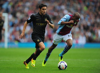 Hi-res-182272750-manchester-city-player-jesus-navas-outpaces-fabian_display_image