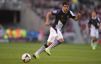 Hi-res-182300134-luis-suarez-of-liverpool-in-action-during-the-barclays_display_image