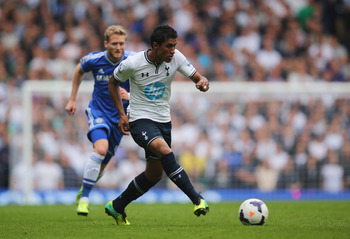 Hi-res-182101343-paulinho-of-tottenham-hotspur-is-chased-by-andre_display_image