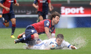 Hi-res-182290167-daniele-conti-of-cagliari-calcio-battles-for-the-ball_display_image
