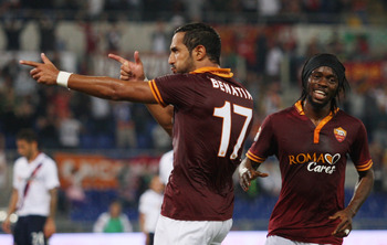 Hi-res-182535716-el-mouttaqui-benatia-with-team-mate-gervinho-of-as-roma_display_image