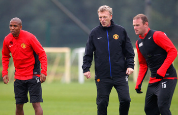 Hi-res-182578529-ashley-young-wayne-rooney-and-manager-david-moyes-of_display_image