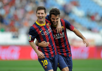 Hi-res-182123775-lionel-messi-of-fc-barcelona-celebrates-with-team-mate_display_image