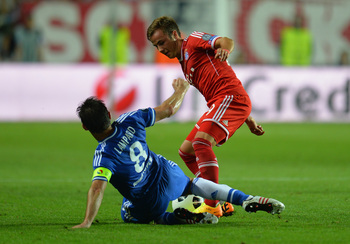 Hi-res-178679658-frank-lampard-of-chelsea-tackles-mario-mandzukic-of_display_image