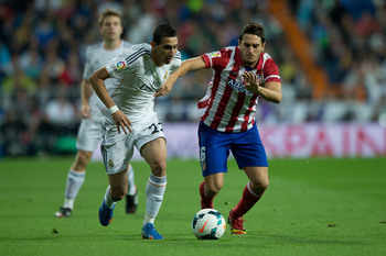 Hi-res-182139532-angel-di-maria-of-real-madrid-cf-competes-for-the-ball_display_image