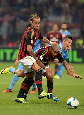 Hi-res-181569977-philippe-mexes-and-nigel-de-jong-of-ac-milan-and-marek_display_image
