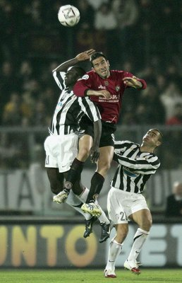 Hi-res-57126120-lilian-thuram-of-juventus-and-cristiano-lucarelli-of_display_image