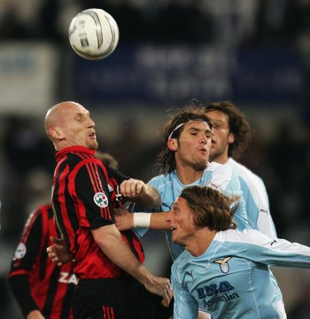 Hi-res-56751465-jaap-stam-of-ac-milan-vies-for-the-ball-with-manuel_display_image