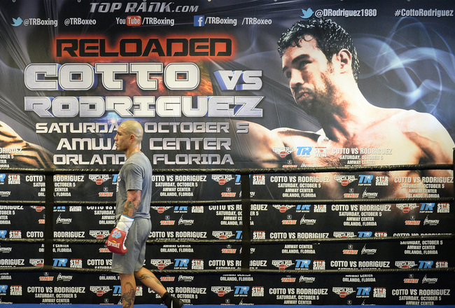 Hi-res-180973858-miguel-cotto-walks-around-the-ring-during-a-break-in_crop_650x440