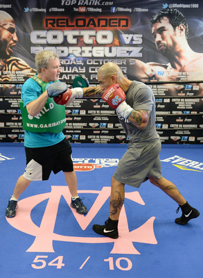 Hi-res-180973595-miguel-cotto-spars-with-trainer-freddie-roach-in_display_image