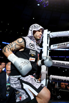 Hi-res-157349500-miguel-cotto-walks-into-the-ring-prior-to-fighting_display_image
