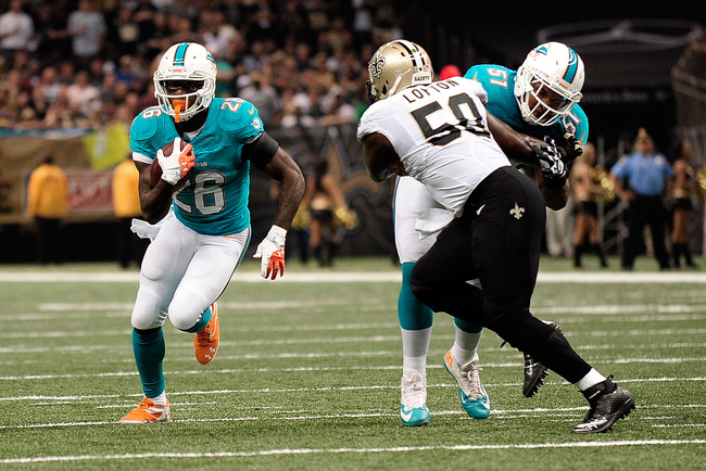 Hi-res-182568695-lamar-miller-of-the-miami-dolphins-runs-for-yards_crop_650