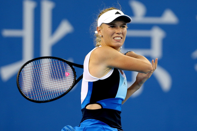 Hi-res-182584875-caroline-wozniacki-of-denmark-returns-a-shot-to-monica_crop_650