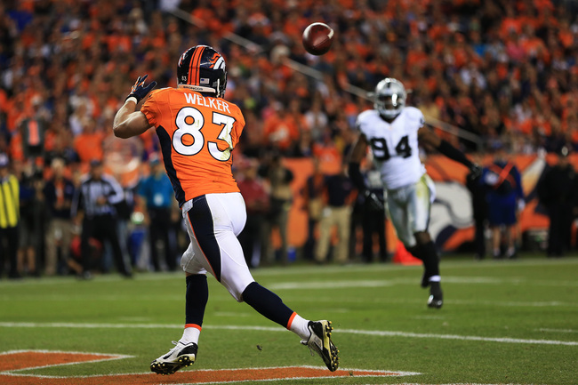 Hi-res-181708871-wes-welker-of-the-denver-broncos-completes-a-touchdown_crop_650