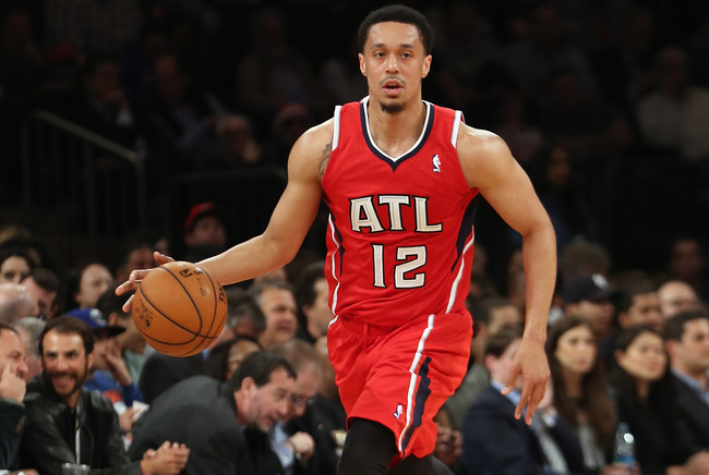 Hi-res-166847614-john-jenkins-of-the-atlanta-hawks-dribbles-the-ball_crop_650