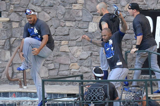 Hi-res-181192359-los-angeles-dodgers-players-jump-in-the-pool-after_crop_650
