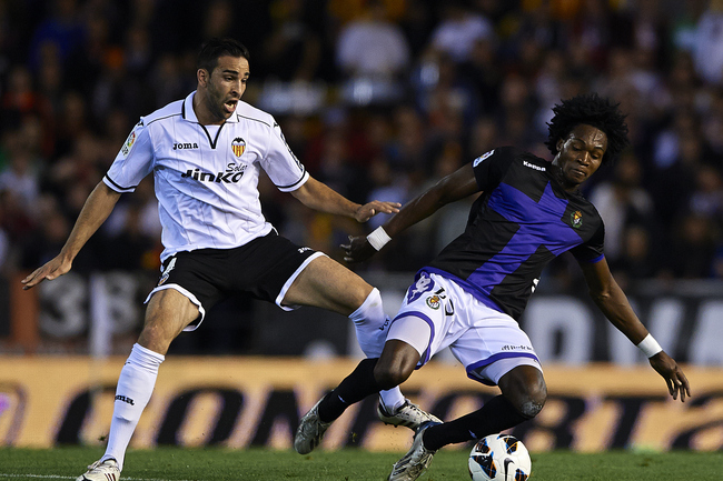 Hi-res-165963207-adil-rami-of-valencia-competes-for-the-ball-with_crop_650