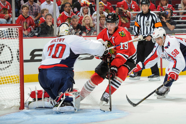 Hi-res-182619119-jonathan-toews-of-the-chicago-blackhawks-takes-the-puck_crop_650
