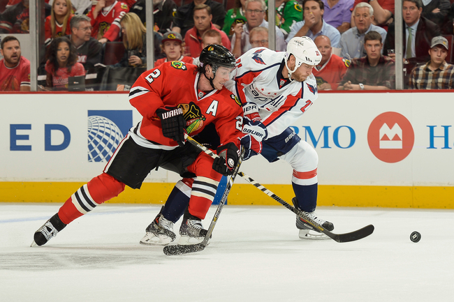Hi-res-182619121-duncan-keith-of-the-chicago-blackhawks-and-brooks-laich_crop_650