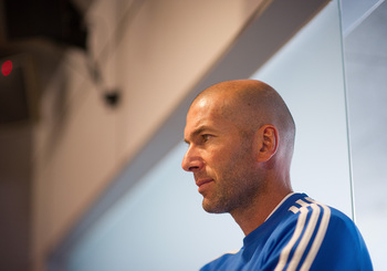 Hi-res-180466850-real-madrids-assistant-coach-zinedine-zidane-looks-on_display_image