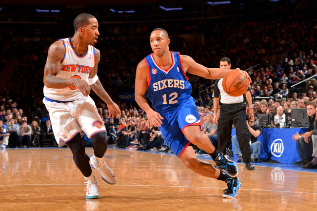 Hi-res-162579584-evan-turner-of-the-philadelphia-76ers-drives-against-j_crop_650