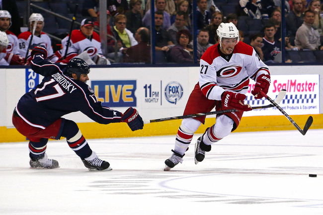 Hi-res-181960620-justin-faulk-of-the-carolina-hurricanes-skates-the-puck_crop_650