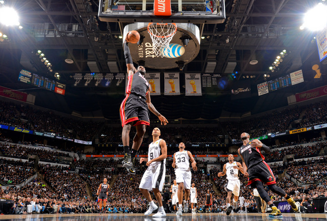 Hi-res-170719926-lebron-james-of-the-miami-heat-dunks-on-a-fast-break_crop_650x440