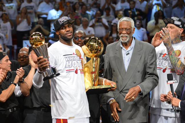Hi-res-171547828-lebron-james-of-the-miami-heat-holds-the-bill-russell_crop_650