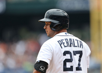 Hi-res-175323644-jhonny-peralta-of-the-detroit-tigers-checks-with-the_display_image