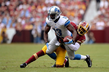 Hi-res-181566495-nate-burleson-of-the-detroit-lions-is-tackled-by-david_display_image