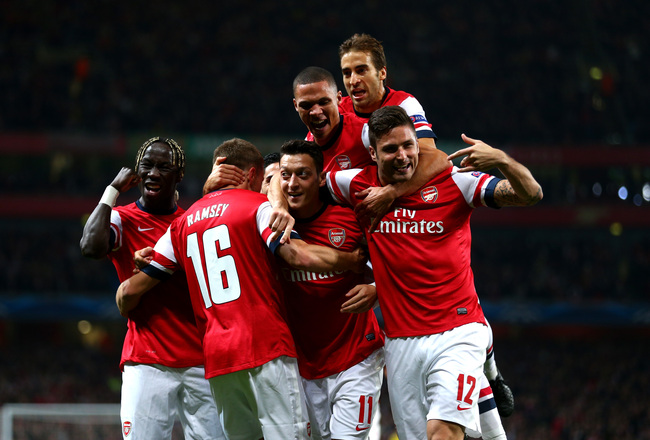 Hi-res-182601306-mesut-oezil-of-arsenal-is-congratulated-by-teammates_crop_650x440