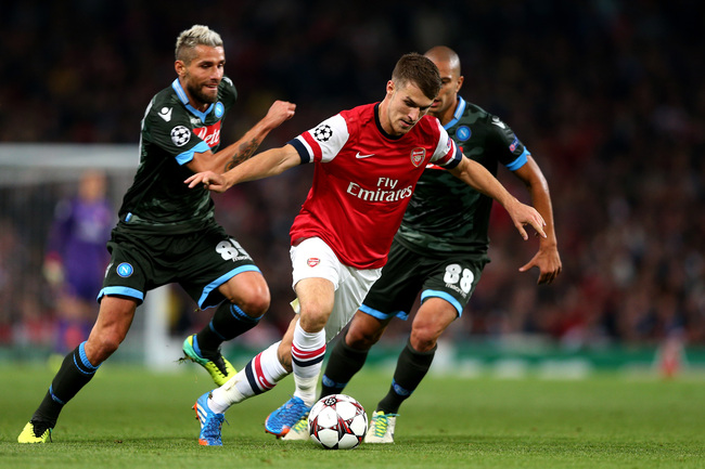 Hi-res-182603506-aaron-ramsey-of-arsenal-is-pursued-by-valon-behrami-and_crop_650