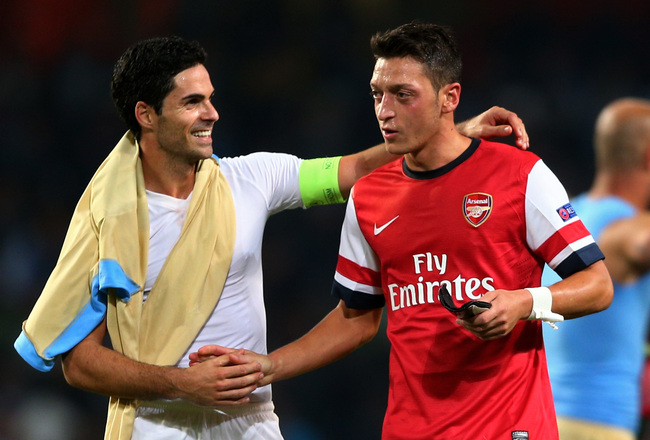 Hi-res-182606944-mikel-arteta-and-mesut-oezil-of-arsenal-celebrate_crop_650x440
