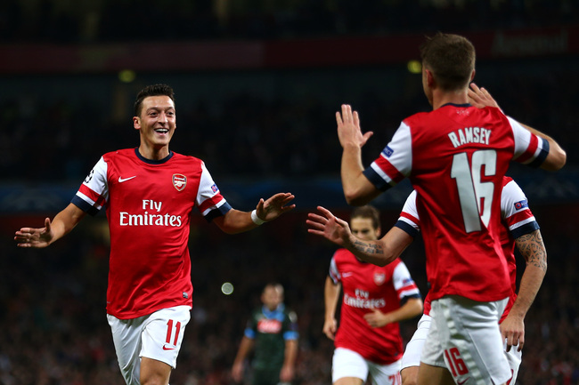 Hi-res-182601461-mesut-oezil-arsenal-is-congratulated-by-teammate-aaron_crop_650