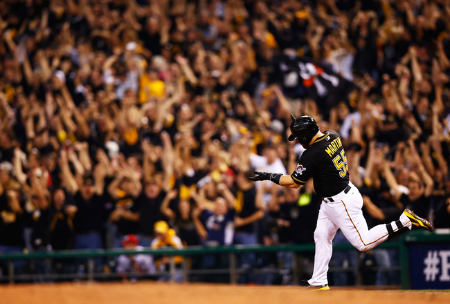 Hi-res-182617895-russell-martin-of-the-pittsburgh-pirates-rounds-the_crop_650x440