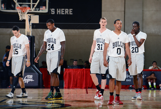 Hi-res-174043471-members-of-the-chicago-bulls-walk-up-the-court-after-a_crop_650x440