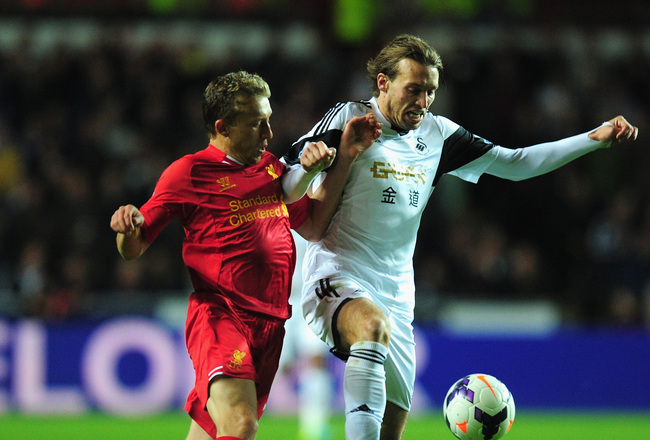 Hi-res-180790110-swansea-player-michu-holds-off-liverpool-defender-lucas_crop_650x440