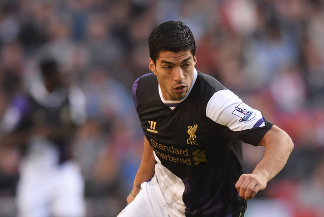 Hi-res-182300136-luis-suarez-of-liverpool-in-action-during-the-barclays_crop_650