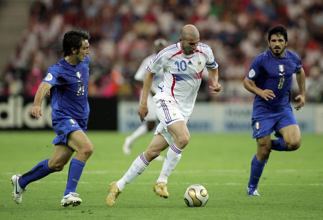 Hi-res-71404888-zinedine-zidane-of-france-goes-past-andrea-pirlo-and_crop_650