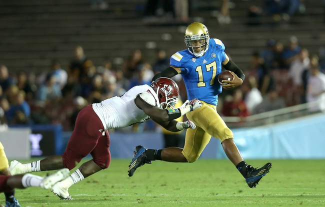 Hi-res-181507809-quarterback-brett-hundley-the-ucla-bruins-carries-the_crop_650