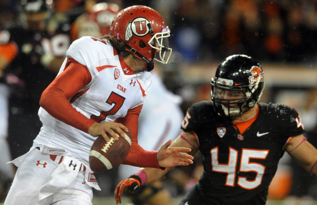 Hi-res-154493863-quarterback-travis-wilson-of-the-utah-utes-scrambles_crop_650